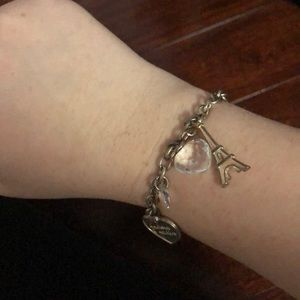 Silver chain bracelet with silver charms